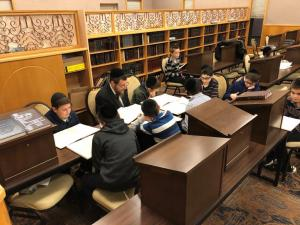 boys learning with Rebbi